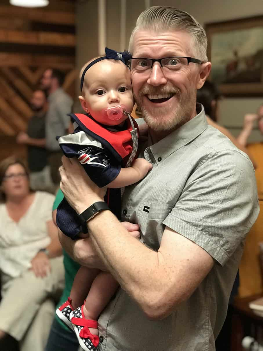 Pastor Adam holding a baby